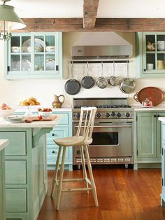 bhg.com ...charming option to have cookware every available especially in a smaller kitchen...the lights in the cabinet open up the space a showcase...the resting home of the grand food I could see myself cooking on that grand stove. Memories are made in this dream kitchen! Love where everything is #YourSet