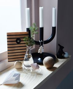 A windowsill is decorated with simple holiday decorations. Plywood windowsill to beef up width.....