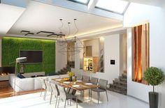 Blick in den Wohnbereich, sehen wir einen Flachbildschirm-TV auf die volle Höhe lebende Mauer montiert, umgeben von Grün und von oben beleuchtet. Dieses überraschende Element gibt den modernen Raum einen nicht mehr glatt, zeitlosen Reiz.