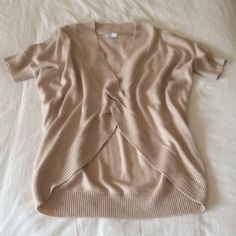 """New York & Company Lightweight Sweater - Lt. Brown New York & Company lightweight sweater in light brown.  Unique silhouette with deep v-neck.  Short sleeves.  Measures approximately 28"""" from shoulder to hem.  100% acrylic New York & Company Sweaters"""