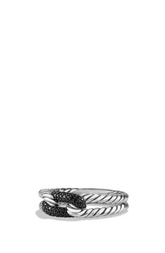 Sterling silver and darkened sterling silver. Pavé diamonds or pavé black diamonds, 0.15 total carat weight. Ring, 4-9mm wide. By David Yurman; imported.
