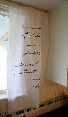 Muslin and french script curtain, gorgeous!