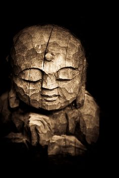 Jizo sculpture in Kyoto, Japan. A lovely piece of art - big confident chisel work, just a few strong strokes in just the right place and the artist/crafsman has captured both the humanity and the mood. Superb. Envious. Humbled.  Jizo - a god who protects children. Some say he was inspired by Jesus hundreds of years ago. (japan...buddism)