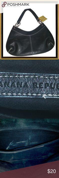 "BANANA REPUBLIC - Small Flat Black Handbag Bag Height:7"" Bag Depth:1/8"" Bag Length:13"" Material:LeatherSize:Small Style:Half MoonStrap Drop:9"" Closure:Magnetic Snap Banana Republic Bags"