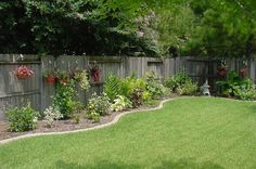 hanging baskets on fence. Love this look for against our fence in backyard