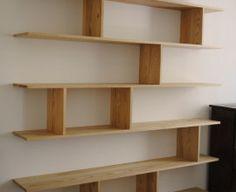 https://i.pinimg.com/236x/20/10/32/201032bb2a21afcbd17c7306200a7962--office-shelving-tv-stands.jpg