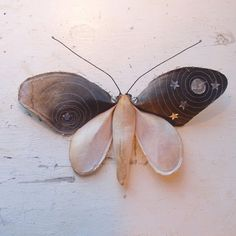 Soft sculpture of a moth with moon and stars