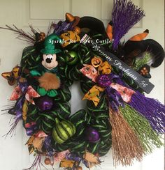 Minnie Mouse Witch Halloween Wreath. Minnie is dressed in green with spider webs…