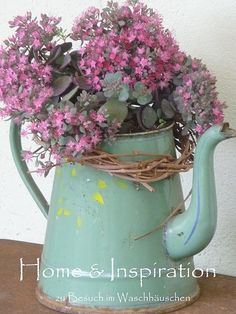 Love this rosy flowers in the turquoise coffee pot.