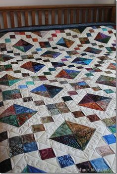 Gorgeous jewel box quilt. Love the colors and the quilting.