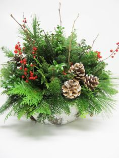 19 a bark wrapped centerpiece with evergreens, branches, berries and pincones - DigsDigs Christmas Flower Arrangements, Christmas Greenery, Christmas Baskets, Holiday Centerpieces, Christmas Tablescapes, Outdoor Christmas, Rustic Christmas, Christmas Wreaths, Christmas Decorations