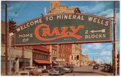 Mineral Wells, Texas  The most famous street marker in the south.  Showing the 80 foot neon sign of the world-famous Crazy Crystals.  Baker Hotel in background.