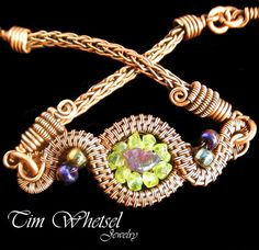 Completely handmade copper wire wrapped bracelet with amethyst and peridot. I handmade all findings, links, jump rings and viking knit band. Antiqued and hand polished.  Size of this item is 7.5 inches. I can made it smaller or larger, please let me know when ordering of the size you need.