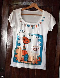 Unique T shirt , hand painted with cute cat in orange and blue colors .  The t shirt is original gift for women and teenage girls .    Fabric 95 %