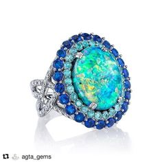 Sloane Street Jewelry. 18K white gold ring featuring a 9.27 ct. black Opal…