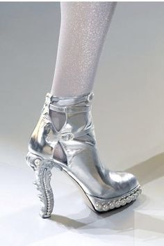 Space-age meets Rococo. Chanel boot.