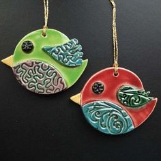 These cute little birds are made from white earthenware clay. Each individual element is hand cut, embossed, decorated and glazed. They measure x each. They look great hanging indoors from your favourite pot plant or just as a decoration i. Ceramic Pendant, Ceramic Jewelry, Clay Jewelry, Owl Pendant, Earthenware Clay, Ceramic Clay, Ceramic Pottery, Clay Birds, Ceramic Birds