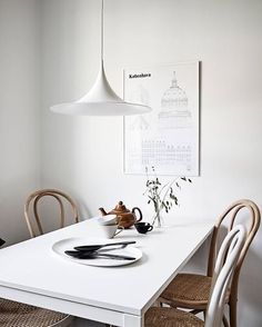 A lovely dining room via @stadshem  Copenhagen poster by Studio Esinam available in our sale  . #diningroom #diningroomdecor #nordichome #nordicinspiration