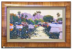 This large tropical painting brought back from Hawaii was framed using a Frank's Fabrics linen scoop liner and a Larson-Juhl Belmont Series frame. The Belmont frame adds the perfect tropical touch to the presentation.
