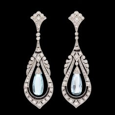 Art Deco Aquamarine and Sapphire Dangle Earrings Platinum Art Deco Earrings feature 2 Briolette Aquamarines Enhanced with 110 Round Cut Diamonds for approximately 1.0 carat along with 24 Dark Blue Faceted Sapphires.