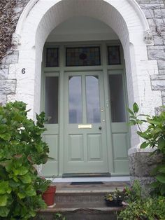 An inspirational image from Farrow & Ball. Double Front Entry Doors, Grey Front Doors, Front Doors With Windows, Green Windows, Front Door Entrance, Front Door Colors, Green Doors, Farrow Ball, Exterior Colors