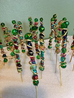 These adorable stakes are the perfect decoration to add to any garden area! They are made from wire and beads. Stakes measure 6 tall (including the wire). The beads measure 3 tall. They are all one of a kind, with no two looking exactly alike. Wire Crafts, Resin Crafts, Bead Crafts, Garden Globes, Glass Garden Art, Garden Spheres, Garden Mural, Garden Totems, Fairy Wands