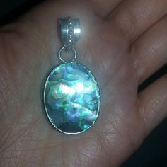 ABALONE SHELL PENDANT, SILVER PLATED Brand new and super gorgeous pattern on this genuine Abalone shell pendant! No two are alike!! Pendant is silver plated over alloy. Jewelry