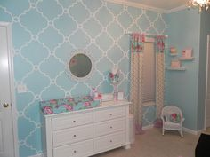 Pretty pink and blue nursery design - Love the stenciled accent wall!