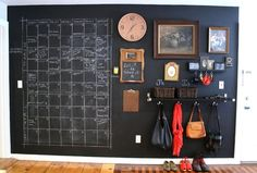 Fun entry wall.  Love the combination of all the frames/clock/hooks.