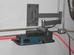 Vise Caddy by Randy -- Homemade vice caddy based on a wall-mounted swinging arm and intended to facilitate the installation or storage of a vise to/from the milling table. http://www.homemadetools.net/homemade-vise-caddy