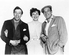 Adolph Green, Betty Comden, and Gene Kelly.