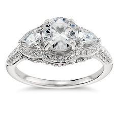 Lavishly romantic, this stunning platinum and diamond engagement ring showcases two diamond sidestones and brilliant micropavé set diamonds for a timeless aesthetic. #BlueNile