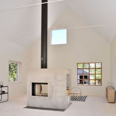 Lofty Swedish house with a concrete fireplace  by Sandell Sandberg
