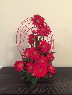 Red gerbera flower arrangement