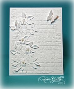 White on White  Susan Goetter: Less is More 14   Tim Holtz brick wall embossing folder Sizzix dies for stems and leaves  EK success punch for small blooms  Martha Stewart Butterfly punch.  Small pearl to the center of each bloom and the butterfly