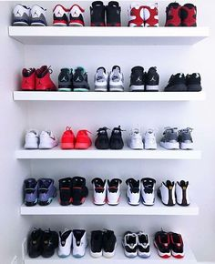 Indented shelf, all white, shows off the colours of the shoes