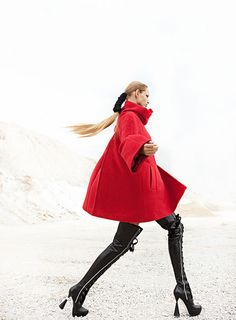 Thigh high boots look incredible when paired with an oversize red cape! #fashion