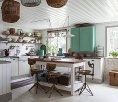 Cocinas con isla multifuncionales para todos los estilos
