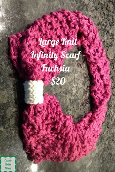 This is a handmade, open-knit, fuchsia infinity scarf with a cream detail.