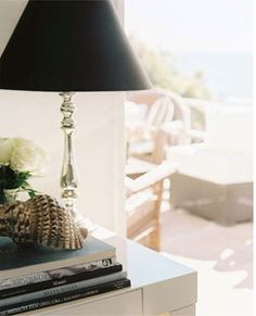 Lighting Photo   A Silver Lamp With A Black Shade On A White Tabletop