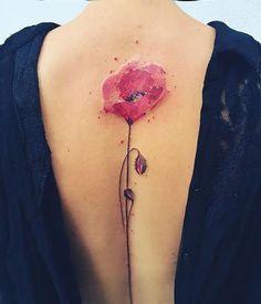 tatuajes en la espina dorsal flor