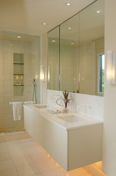 White bathroom with floating vanity lighting - nice and tidy
