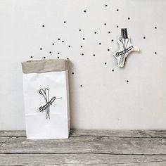 Paper bags with mosquito design. Via en.DaWanda.com.
