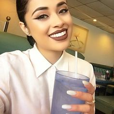 """I have no idea why I took a picture with the water cup like this 😂 Many people said this look wasn't """"my look"""", who cares about what anyone thinks as long as you feel good?!!!!! 🖕🏼✋🏼 What do people know about """"your look"""" anyways?! One day I'm super girly & another I might be like a boy?! It's about experimenting and enjoying life people! 💪🏼 ANYWAYS 👉🏼 #FUNFACT: Drinking a lot of water helps your face from breaking out AND brown lipstick makes your teeth look whiter 😍 #MOTD #Lipstick…"""