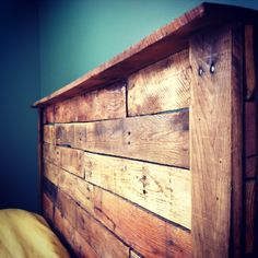 Pallet Headboard. I love rustic wood tones against the vibrant yellow & blue.