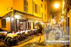 Europe, France, Alpes-Maritimes, Cannes. Tourists in old city at night.