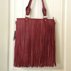NWT FRINGE TOTE New with tags fringe tote. Red vegan leather, fringe is on both sides. Comes with a crossbody strap. Boutique brand  Bags Totes