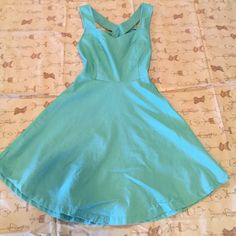 Bow back dress small Pale turquoise fit n flare bow back dress with side zipper. Reposhing, never worn just washed. Bow needs to be ironed down. No stains or rips. Size small. Dresses Mini