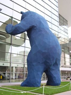 Lawrence Argent's Big Blue Bear sculpture which looks into the convention center of the Denver university.