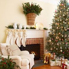 I like the clean, white decor.  Elegant.  Note how they tied the pillow cover on with ribbons?  Great, inexpensive way to spruce up pillows on a temp. basis for the holidays.  Use tea towels or Christmas themed fabric to coordinate with your decor.
